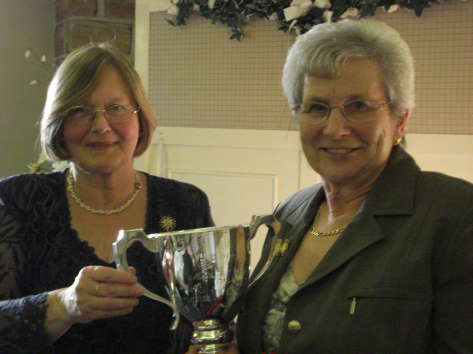Eileen Hallifield receives The John Spalton Trophy for the Best Medium Herd from Mrs. Nicholson, sister of the late John Spalton