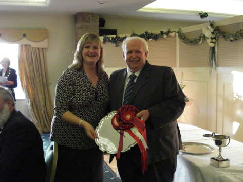 John Warner receives the Fitzwilliam Salver for the Best Small Herd from Mrs. Wyllie